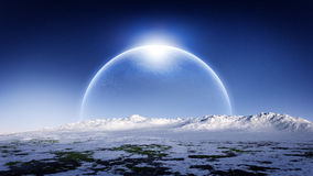 Ice Planet Rising On Ice Landscape Horizon. Cold and unknown alien planet with rings rising on the horizon of a cold distant planet with hazy atmosphere and Royalty Free Stock Photos