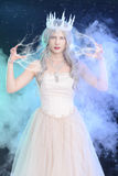 Ice queen with lighting magic. And fog stock photo