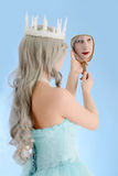 Ice queen looking in mirror stock image