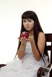 Ice queen woman with apple Stock Photo