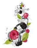 Ice raspberries and blackberries Stock Photo