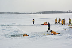 Ice Rescue Training. Instructors leading ice rescue training Royalty Free Stock Photo