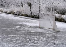Ice ring and hockey net. Natural ice ring on the pond and hockey net stock photography