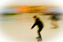 Ice rink. Crowd of people rushing on the ice rink in motion blur Royalty Free Stock Image