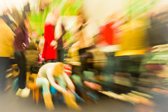 Ice rink. Crowd of people rushing on the ice rink in motion blur Royalty Free Stock Images