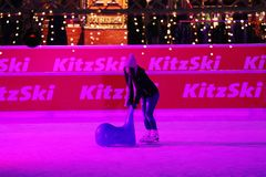 Iceskaters, Christmas Market in Munich Airport, Germany stock photography