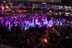 Iceskaters, Christmas Market in Munich Airport, Germany royalty free stock photography