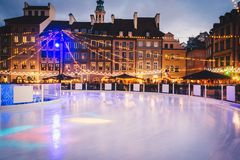 Ice rink open street arena. Winter entertainment. Iceskating in the city stock images
