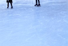 Ice Rink Texture. With skaters Stock Photo
