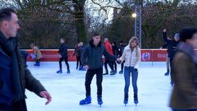 Ice rink at winter wonderland Christmas market in London - LONDON, ENGLAND - DECEMBER 11, 2019