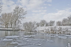 Ice river. Ice floats down a winter river in this HDR edit Royalty Free Stock Image