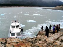 Ice river. People waiting for a boat in a ice river, glacier Perito Moreno, Argentina Stock Photography