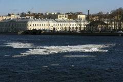 Ice on the river, blue water, city, home, building, promenade, c Royalty Free Stock Image
