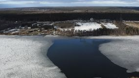 Ice on the river covered with fluffy white snow.  stock footage