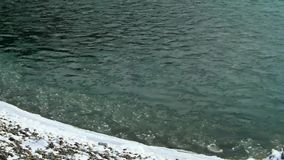 The Ice On The River. Winter river in the mountain. Slow motion stock footage
