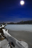Ice on the river lit by moonlight. Stock Photo