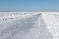 Ice road in snow on the frozen water reservoir in the winter. The Ob River, Siberia, Russia Royalty Free Stock Photo