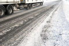 Ice road trucking. Parts of a truck seen driving on an icy highway Royalty Free Stock Image