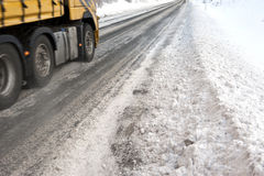 Ice road trucking. Part of a truck seen driving on an icy road Stock Photo
