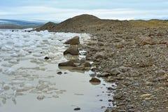 Ice and rock coast. Coast of  Fjallsarlon glacier lake, Iceland Royalty Free Stock Image