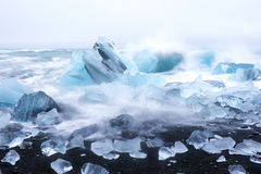 Ice rocks on a black sand beach Iceland Royalty Free Stock Photography