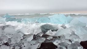 Ice rocks on a black sand beach in Iceland stock footage