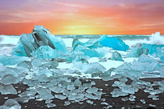 Ice rocks on a black sand beach at Jokulsarlon in Iceland at twi Royalty Free Stock Photos