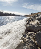 Ice and Rocks by River Royalty Free Stock Photography
