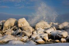 Ice rocks on sea coast stock photo