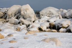 Ice rocks on sea coast in winter Royalty Free Stock Photo