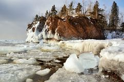 Ice and Rocky Shoreline in Winter Stock Photos