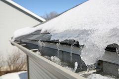 Ice on roof and gutters. A build up of ice on the edge of a roof Royalty Free Stock Photo