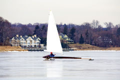 Ice Sailing Boater. Man using ice sail boat on river Stock Images
