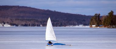 Ice sailing in froze lake in north Michigan during winter. In lake Michigan charlevoix Stock Photo