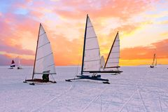 Ice sailing on the Gouwzee in the Netherlands. Ice sailing on the Gouwzee in the countryside from the Netherlands at sunset Royalty Free Stock Photos