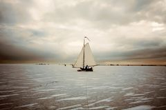 Ice sailing on the Gouwzee in the Netherlands. At sunset Royalty Free Stock Images