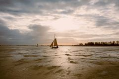 Ice sailing on the Gouwzee in the Netherlands. At sunset Royalty Free Stock Photography