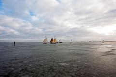 Ice sailing on the Gouwzee in the Netherlands. At sunset Stock Photo