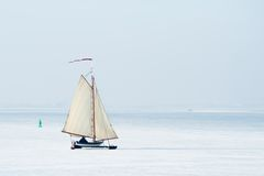 Ice sailing in the Netherlands. Ice sailing on the frozen lake (gouwzee Between Edam and Marken Netherlands Royalty Free Stock Photo