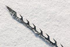 Ice saw blade on snow Stock Photos