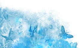 Ice scene corner. Icy winter scene of various crystalline elements, like ice flowers, snowflakes, ice textures and glass crystal animals in a layered composition Royalty Free Stock Images