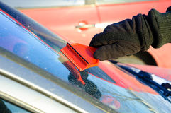 Ice scraping - removing ice and snow from car Royalty Free Stock Image