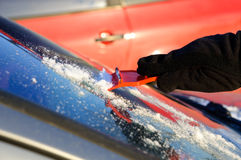 Ice scraping - removing ice and snow from car Royalty Free Stock Images
