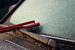 Ice Scrapper on the Windowscreen. Ice on the windscreen and ice scrapper, driving in winter concept Royalty Free Stock Images
