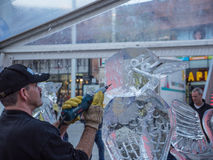 Ice sculpting at Sculpture Festival Royalty Free Stock Photo