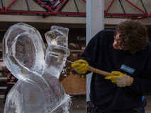 Ice sculptor at work Royalty Free Stock Image