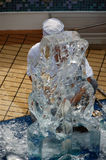 Ice sculpture. Man carving sculpture out of ice royalty free stock image