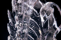 Ice sculpture. On a black background Royalty Free Stock Photography