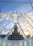 Ice sculpture against City Hall. Royalty Free Stock Images