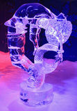 Ice sculpture of dragon and girl, illuminated at night in Confederation Park, Winterlude Event in Ottawa Stock Photo